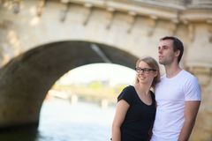 Young couple in Paris on the embankment Stock Image