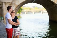 Young couple in Paris on the embankment Royalty Free Stock Image