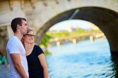 Young couple in Paris on the embankment royalty free stock photo