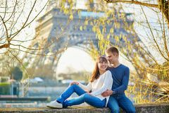 Young couple in Paris near the Eiffel tower Royalty Free Stock Photo