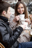 Young couple in a Parisian street cafe. Drinking coffee stock photos