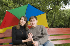 Young couple in a park Royalty Free Stock Photos