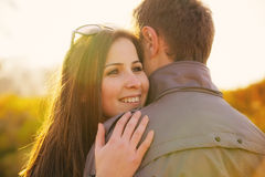 Young couple at the park in autumn Stock Images