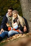 Young couple in park at autumn Royalty Free Stock Photos