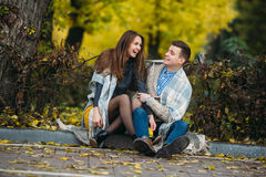 Young couple at the park in autumn season Royalty Free Stock Images