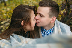 Young couple at the park in autumn season Stock Photo