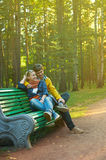 Young couple on a park bench Royalty Free Stock Photography
