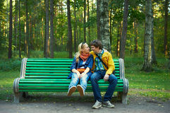 Young couple on a park bench Stock Images
