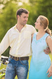 Young Couple in The Park with Bicycle Royalty Free Stock Image