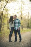 Couple holding hands kissing in the park royalty free stock images