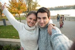 Young couple in park stock photos