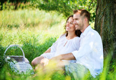 Young Couple in a Park. Picnic. Young Couple Having Picnic in a Park. Happy Family Outdoor Stock Images