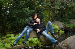 Young couple in park on a shore Stock Images