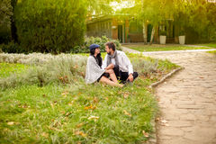 Young couple in the park. Young couple spending time together in the park stock image