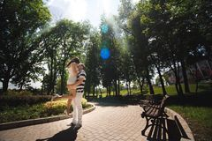 Young couple at the park in a summer time stock image