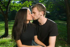 Young couple in park on a sunny day Stock Photography