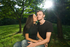 Young couple in park on a sunny day Stock Photos