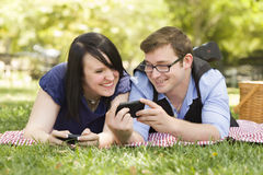 Young Couple at Park Texting Together Stock Image