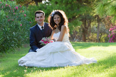 Young couple in the park after wedding Stock Photos