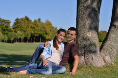 Young couple in parkland Stock Image