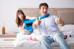 The young couple partying in the bed. Young couple partying in the bed royalty free stock images