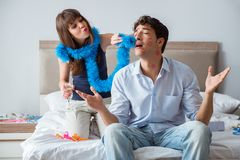 The young couple partying in the bed Royalty Free Stock Photography