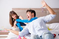 The young couple partying in the bed Stock Images