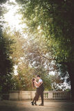 Young couple passion and love outdoor. Trees and nature. Natural love. A beautiful young couple, men and woman, close to each other in a tight embrace. Love and Royalty Free Stock Images