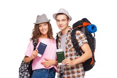 Young couple with passports. Happy young couple of tourists smiling and  holding passports Stock Photos