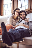Young couple paying attention to TV Stock Image