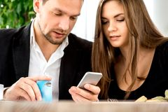 Young couple paying for ther order at the Stock Photo