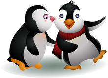 Young couple penguin cartoon kising Royalty Free Stock Image