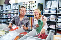 Young couple people at clothes shopping Royalty Free Stock Photos