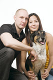 Young couple with pet dog Stock Images