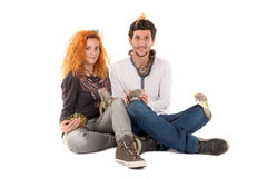 Young couple with pets Royalty Free Stock Images
