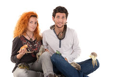 Young couple with pets Royalty Free Stock Photography