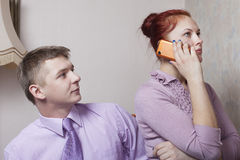 Young couple and phone. Royalty Free Stock Image