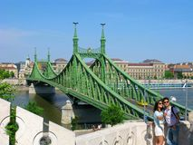 Young couple, photo selfie by smartphone, Budapest, Liberty bridge royalty free stock photography