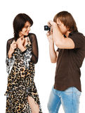 Young couple photographing on white Royalty Free Stock Photos