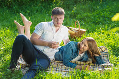 Young couple at a picnic in a city park Stock Images
