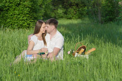 Young couple at a picnic in a city park Stock Photo