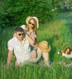 Young couple at a picnic in a city park Royalty Free Stock Photo