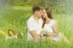 Young couple at a picnic in a city park Stock Photos