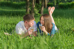 Young couple at a picnic in a city park Royalty Free Stock Image