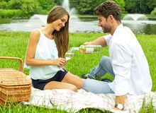 Young couple on picnic drinking white wine Royalty Free Stock Photos
