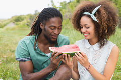 Young couple on a picnic eating watermelon Royalty Free Stock Images