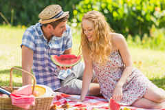 Young couple on a picnic eating watermelon Stock Image