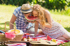 Young couple on a picnic eating watermelon Royalty Free Stock Photo
