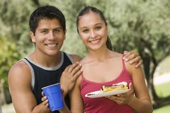 Young couple at picnic front view. Royalty Free Stock Photography