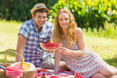 Young couple on a picnic holding watermelon Royalty Free Stock Images